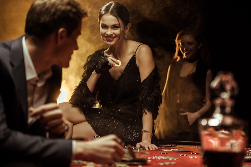 Woman Black Sequin Dress Casino Table